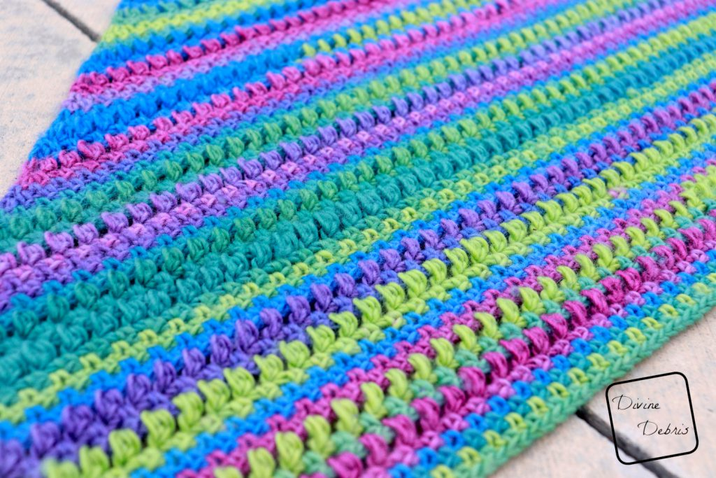 Learn to make the Whitney Shawl, an easy crochet shawl design that works wonderfully in one or more colors, from a free crochet pattern on DivineDebris.com